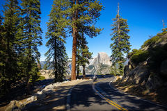 Bikers on Windy Road with Half Dome View royalty free stock photo