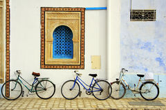 Bikes. Leaned on a colorful wall royalty free stock photos