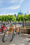 Bikes against the Berlin Cathedral. Bikes against the Berliner Dom Cathedral, Berlin TV Tower and Spree River in Berlin, Germany Royalty Free Stock Photos