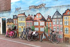 Street art graffiti of old canal houses in Amsterdam style,Leeuwarden, Netherlands Royalty Free Stock Photos