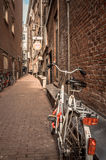 Bikes at an alley Royalty Free Stock Photo