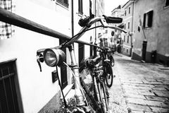 Bikes in the alley. Some bikes in an old alley Royalty Free Stock Images