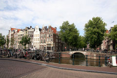 Bikes Along Amsterdam Canal Stock Images