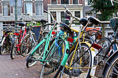 Bikes in Amsterdam. Old colored bikes in amsterdam city Royalty Free Stock Photo