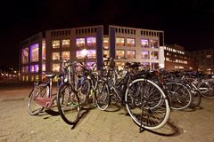 Bikes in Amsterdam the Netherlands by night. Bikes in Amsterdam city center in the Netherlands by night Royalty Free Stock Image