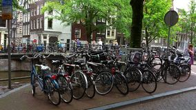 Bikes attached to a bridge in Amsterdam  City of Amsterdam stock video