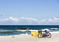 Bikes at a beach. Two bikes standing on an empty beach royalty free stock image