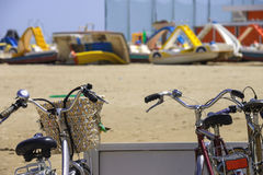 Bikes on the beach parking lot Stock Images