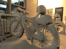Bikes in bike rack covered in snow in the winter Royalty Free Stock Photos