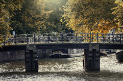 Bikes on a bridge on a canal in Amsterdam, Netherlands Royalty Free Stock Image