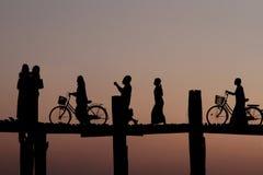Bikes on the bridge at sunset Stock Photos