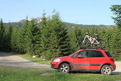 Bikes on a car in the mountain. Bikes on a car on the mountain road stock image