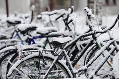 Bikes covered with a blanket of snow Royalty Free Stock Photography