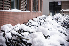 Bikes covered by snow Stock Photos