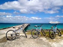 Bikes with cruise ship in background Royalty Free Stock Photos