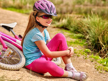 Bikes cycling family. Child sitting on road near bicycles. Royalty Free Stock Images