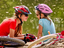 Bikes cycling family. Happy mother and daughter  rides bicycle. Royalty Free Stock Photo