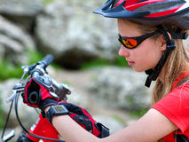 Bikes cycling girl. Bicyclist girl watch on smart watch. Stock Photo