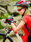 Bikes cycling girl. Bicyclist girl watch on smart watch. Royalty Free Stock Photos