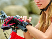Bikes cycling girl. Bicyclist girl watch on watches. Stock Photography