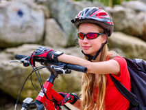 Bikes cycling girl. Bicyclist girl watch on watches. Stock Image
