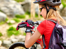 Bikes cycling girl. Bicyclist look on smart watch. Royalty Free Stock Photography