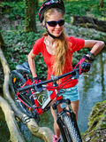 Bikes cycling girl cycling fording throught water . Stock Images