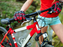 Bikes cycling girl cycling fording throught water . Royalty Free Stock Photos