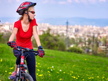 Bikes cycling girl. Girl rides bicycle out city. Stock Photos