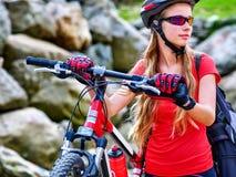 Bikes cycling girl into park. Stock Photo
