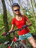 Bikes cycling girl into park. Stock Photos