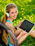 Bikes cycling girl wearing headset watch in pc tablet . Royalty Free Stock Image