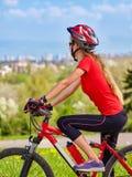 Bikes cycling girl wearing helmet. Stock Photos