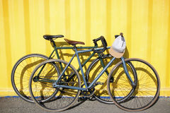 Bikes on each other on a yellow background Stock Image