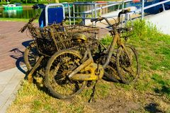 Bikes fished out of the canal by city cleaners stock images