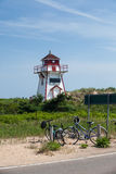 Bikes in front of lighthouse Stock Photography