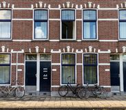 Bikes in front of red brick house in Rotterdam, background royalty free stock photo