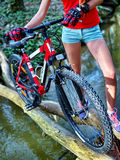 Bikes girl cycling fording throught water . Stock Photos