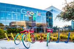 Bikes at Googleplex - Google Headquarters. Mountain View, Ca USA December 29, 2016: Googleplex - Google Headquarters with biked on foreground Royalty Free Stock Photos