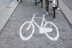 Bikes Lane Symbol and Cyclists, Amsterdam Royalty Free Stock Image