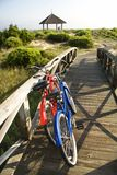 Bikes leaning against ralling. Royalty Free Stock Photos