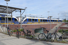 Bikes and modern commuter train in Germany Stock Photo