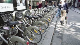 Bikes on Paris city street available for rental stock video footage