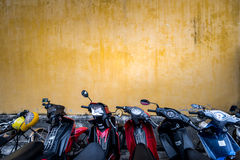 Bikes parked near building with grungy wall. Royalty Free Stock Image
