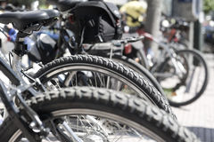 Bikes parked on the pavement. Stock Images