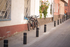 Bikes parked on the street Stock Images