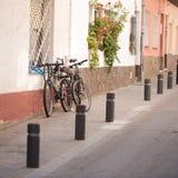 Bikes parked on the street Stock Photos