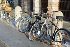 Bikes parked on streets of European city Royalty Free Stock Images