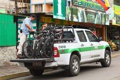 Bikes on Pickup Truck in Banos, Ecuador. BANOS, ECUADOR - FEBRUARY 25, 2014: Unidentified man with mountain bikes on a pickup truck in front of a tour operator Stock Photos