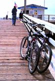 Bikes at the Pier. This photo is of two bikes at the pier at Pismo Beach in California Stock Image
